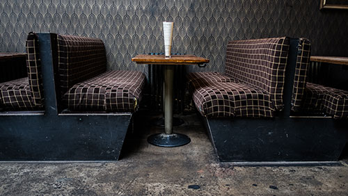 A table for two at a restaurant - what is a sober companion?  Hired Power offers recovery assistance services in Southern California and across the US