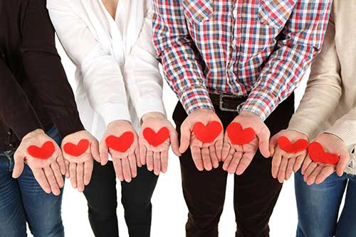 image of people holding heart shapes in their hands - addiction recovery support for alcohol and substance abuse - hired power offers recovery assistance services - sober coaches - sober companions in southern california and nationwide