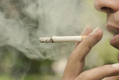 smoking cigarette man